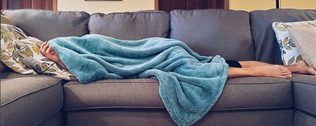 Image of People Sleeping in Couch