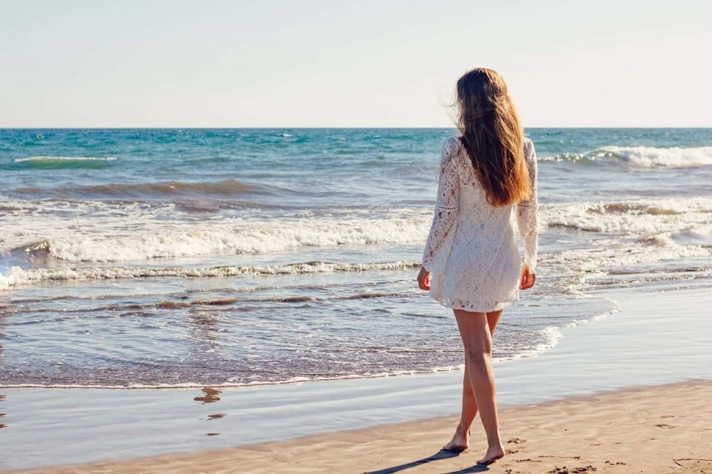 Image of Young Woman On Beach